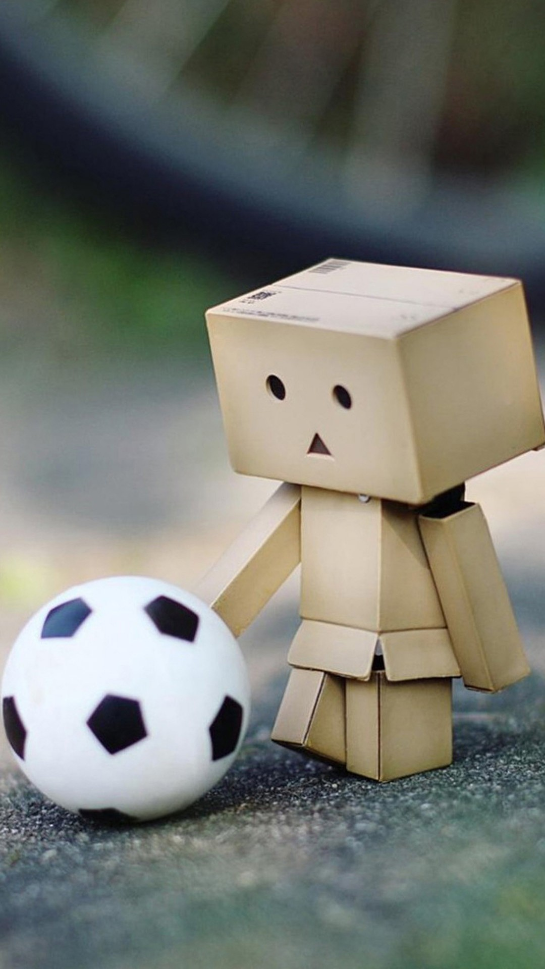 a little box playing soccer wallpaper background