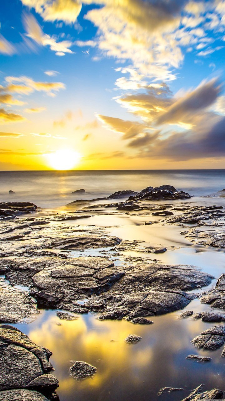 rocks beach and sun wallpaper background